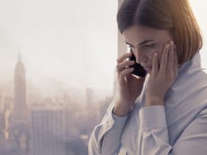 Business woman receiving a phone call in the office